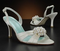 Elegant bridal sandals with high heels and decorative elements